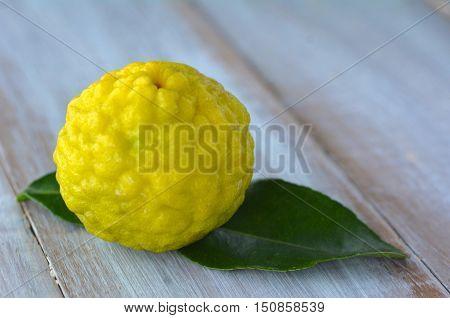 Kaffir Lime On A Wooden Table