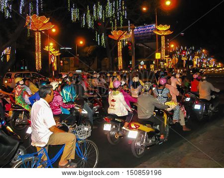 Hanoi, Vietnam - February 10, 2011: Many motorbikikes at the street at night in Ho Chi Minh City, Vietnam. Motorbike is a most popular transport in Vietnam.