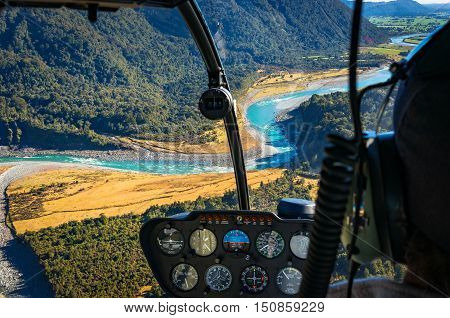 View from helicopter on beautiful landscape of mountain river. Whataroa South Island New Zealand. Selective focus on landscape