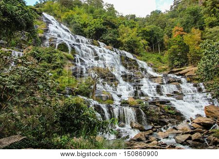 Natural waterfall in a tropical mountain forest