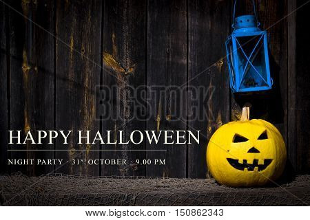 halloween. Scary pumpkin Jack-o-lantern and an old lantern on wooden background. Text Happy Halloween on October 31.The place to advertise.