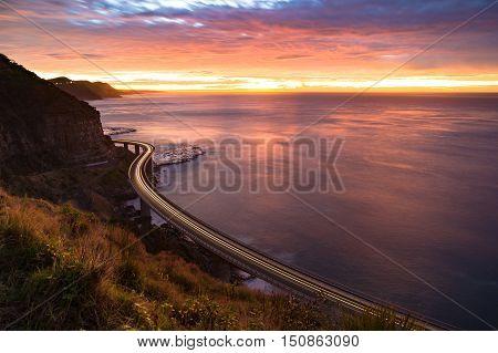 Sea Cliff Bridge On Sunrise With Moving Traffic