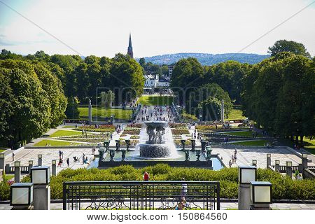 EDITORIAL OSLO NORWAY - AUGUST 18 2016: Many tourist walk Vigeland Sculptures Park in the popular Vigeland park ( Frogner Park ) designed by Gustav Vigeland in Oslo Norway on August 18 2016.