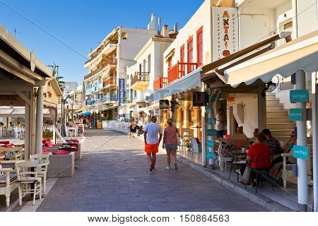 NAXOS, GREECE - SEPTEMBER 23, 2016: Shops at the seafront of Naxos town on September 23, 2016.