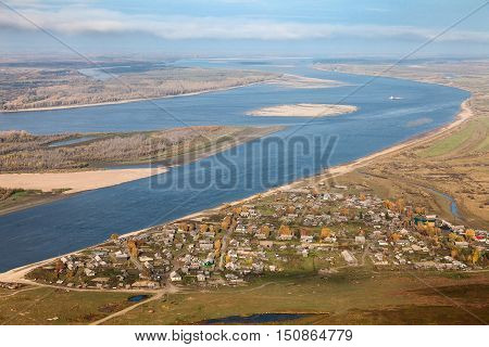 Aerial view the village which is on the coast of the Ob river. It's great siberian river.