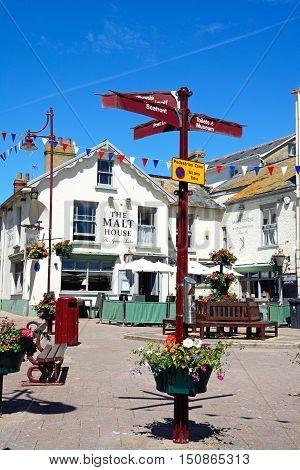 SEATON, UNITED KINGDOM - JULY 18, 2016 -Signpost with the Malt House Pub to the rear Seaton Devon England UK Western Europe, July 18, 2016.
