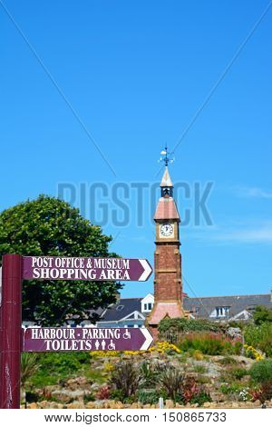 Signpost for Post Office and Museum with the Jubilee clock tower to the rear Seaton Devon England UK Western Europe.