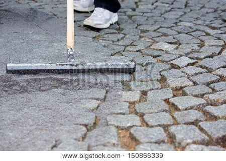 Worker Resurfacing Cobblestones