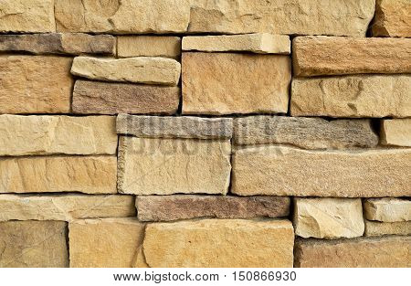 Background Pattern The Horizontal Brown Asymmetrical Stone Wall Background or Texture.