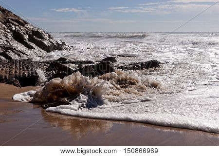 Waves on the beach Areia Branca. Lourinha, west coast of Portugal