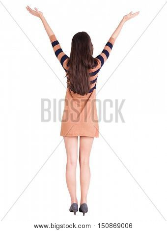 Back view of happy woman in dress. Rear view people collection.  backside view of person.  Isolated over white background. girl raised her hands up to God rejoicing