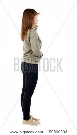 side  view of standing young beautiful  woman. girl  watching. Rear view people collection.  backside view of person.  Isolated over white background. A girl in a gray jacket covers her eyes.