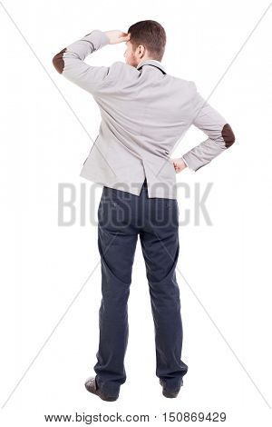 back view of Business man  looks.  Rear view people collection.  backside view of person.  Isolated over white background. A guy in a jacket looking away from doing hands visor.