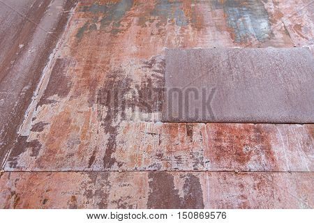 Looking up the exterior of a building in rust metal.