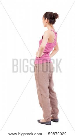 back view of standing young beautiful  woman.  girl  watching. Rear view people collection.  backside view of person.  Isolated over white background. African-American woman in brown slacks put his