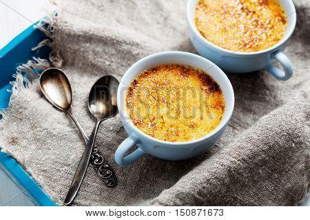 Homemade vanilla creme brulee for three