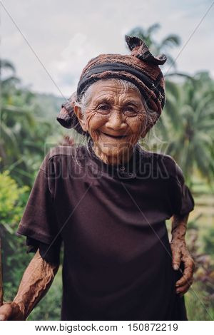Old Woman Standing Outdoors And Smiling