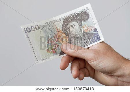 Hand holding swedish 1000 SEK bank note with the swedish king Gustav Vasa layout before 2016