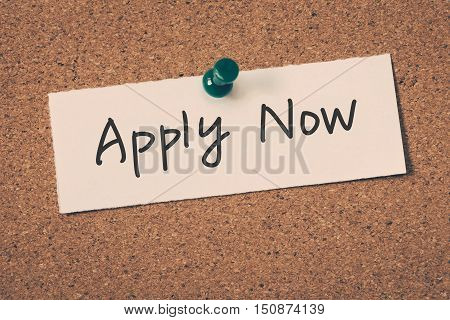 Apply Now. note message on a bulletin board