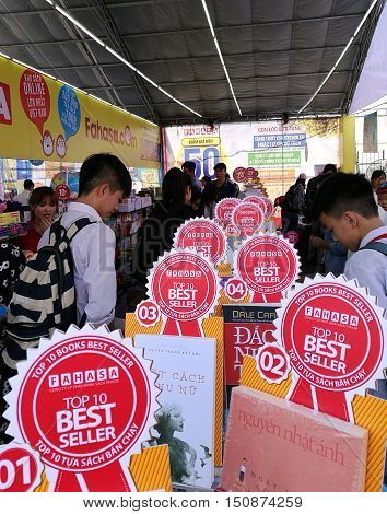 Hanoi, Vietnam - Oct 6, 2016: Readers take a look and choosing favorite book inside a book store at a book festival at The Imperial Citadel of Thang Long in Hanoi capital.