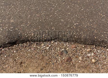 Asphalt Roadside And Sand.