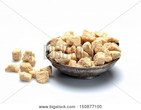 Vintage metal sugar bowl with brown sugar on a white background