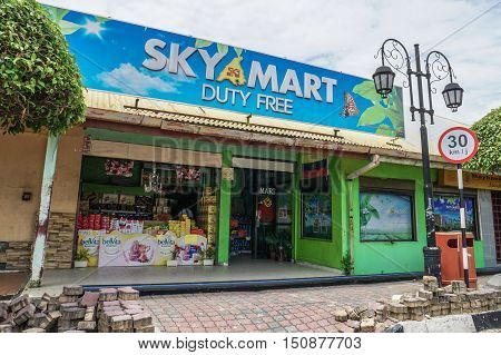 Labuan, Malaysia - Oct 9, 2016: Duty free shop in Labuan Island Malaysia. The cheap, duty free products like alcohol and cigarettes are among the main attractions of the island and will remain a duty-free island.