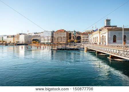 Geneva, Switzerland - June 23, 2016: Riverside buildings with offices of famous brands in the center of Geneva city. Geneva is a financial center and worldwide center for diplomacy in Europe
