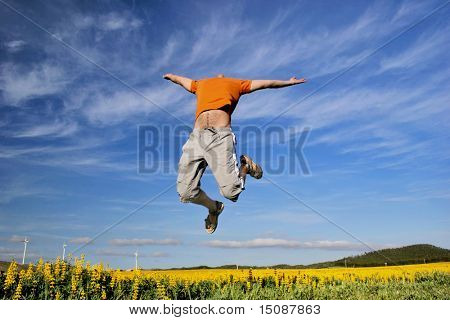 Jump to the sky over a flowery field
