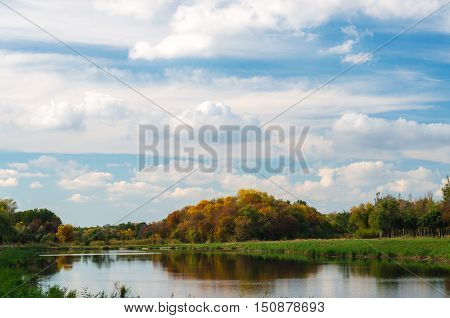 Autumn Forest And Lake In The Fall Season. Beautifull Sky Background.