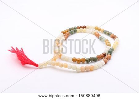 Bead Necklace with Red Tassel on White Background