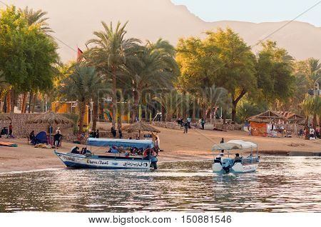 Aqaba Jordan - November 20 2010: Jordanian boatmen waiting for tourists at November 20 2010 in the harbor of Aqaba Jordan