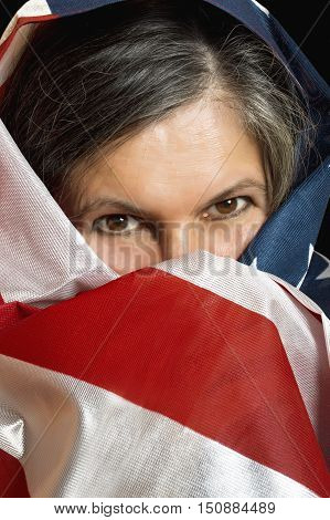 Adult woman wrapped in a United States flag.