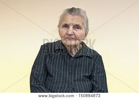 Portrait of an old woman. Dreaming the past.