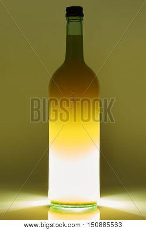 Bottle With White Liquid On Back Light