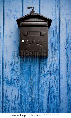Mailbox in a blue door