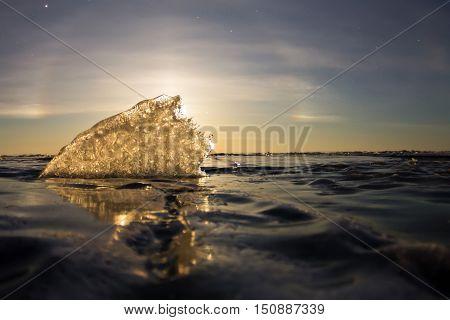 A Lunar Halo Shining Through The Transparent Ice Ridge, Olkhon Island, Lake Baikal