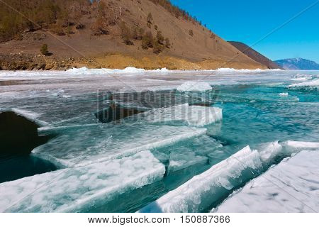 Clumps Of Blue Ice Floating In The Water In A Crack Near The Shore. Lake Baikal
