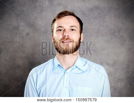 Young Bearded Man In Blue Shir