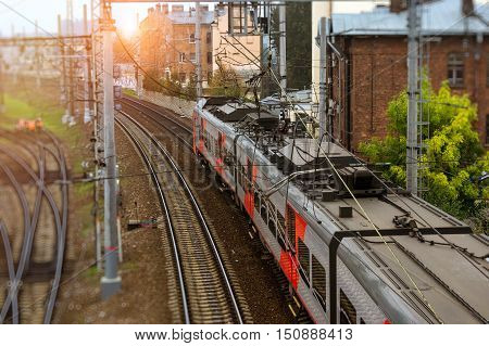 Modern electric locomotive pulling a high-speed train on rails. Technical railway operational locomotive depot on morning. Transport infrastructure of railways route St. Petersburg - Moscow Russia