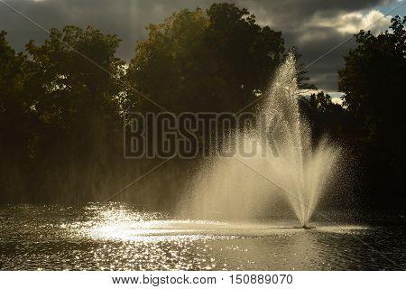 Fountain Dark background back-lit Landscape Bright Cloudy