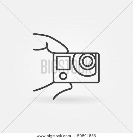 Action camera concept icon. Vector thin line extreme action cam in fingers symbol or logo element