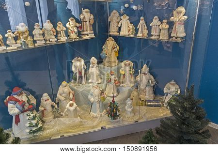 KLIN RUSSIA - JANUARY 16 2016: Figurines of Fathers Frost and Snow Maidens. Museum of Christmas toys. Russian Father Frost and Santa Claus are similar but different fairy-tale characters