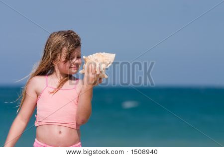 Girl At Beach With Shell
