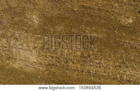 Texture of the soil, soil texture, nature background, ground, brown ground, sand, tire tracks