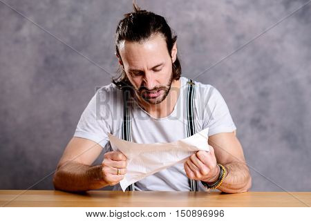 Man Is Annoyed About A Letter