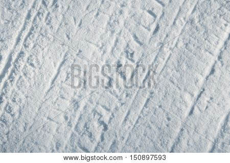 Car tire tracks in fresh snow for background