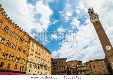 Piazza del Campo in Siena under a cloudy sky Italy