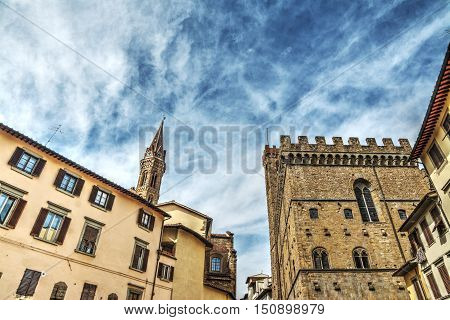 Badia Fiorentina steeple and Museo del Bargello in Florence Italy
