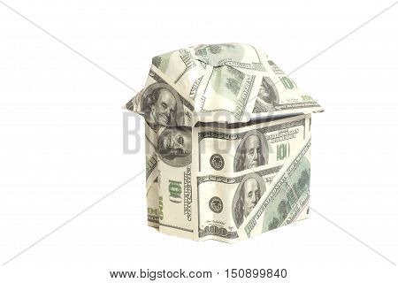 House made of 100 dollar banknotes isolated on white background